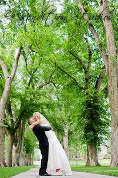 Fort Collins Colorado CSU Campus Wedding In The Oval Couple Lifting
