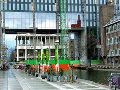 Photo of the construction site of the main university building  and gate, on Roetereiland in Amsterdam city; canal is Nieuwe Achtergracht under the gate, to the left Crea-student-cafe; - urban photography by Fons Heijnsbroek, the Netherlands, 2013