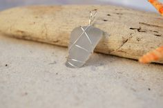 A personal favorite from my Etsy shop https://www.etsy.com/listing/248549827/grey-sea-glass-pendant-genuine-rare-grey