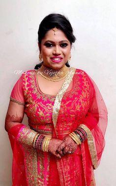 Varsha looks pretty for her reception in a bridal lehenga. Makeup and hairstyle by Swank Studio. Pink lips. South Indian bride. Eye makeup. Bridal jewelry. Bridal hair. Silk sari. Bridal Saree Blouse Design. Indian Bridal Makeup. Indian Bride. Gold Jewellery. Statement Blouse. Tamil bride. Telugu bride. Kannada bride. Hindu bride. Malayalee bride. Find us at https://www.facebook.com/SwankStudioBangalore