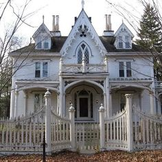Beautiful white home with gothic architectural details. Love the lancet windows!