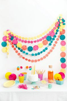 Fun + bright bridal shower decor idea - pink, yellow, orange + teal garland + honeycomb {Courtesy of Tell Love and Party}