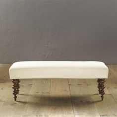 Simone Bench by Ballard Designs.  It can be upholstered in any fabric and starts at $249.  I especially love the turned ball legs.