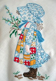 I have a Holly Hobbie needlework piece that I finished when I was 15 yrs old.  I bought the kit at Rich's in downtown Atlanta while shopping with my dear, and now late, aunt Beth.  I won a 1st place Blue Ribbon at the county fair for this piece.  I had so much fun doing this and I still love the design!  :)