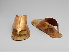 Sandals  These Gold sandals belonged to the funerary accoutrements of an Egyptian queen of Thutmose III in the middle of Dynasty 18. Similar gold sandals were found on the mummy of Tutankhamun, one of Thutmose's descendents who ruled at the end of the same dynasty.