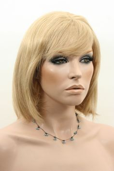 Dakota 100% Human Hair Wig  Dakota is a stylish medium Bob wig that can be cut and styled to suit. The versatility of human hair gives you the option of styling with heat or colouring by a professional stylist. It has a natural looking Skin Top centre part and is 14 inches/35 cm in length.   Colour displayed - 24
