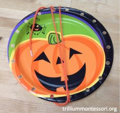 Simple lacing cards using jack-o-lantern paper plates-fine motor.