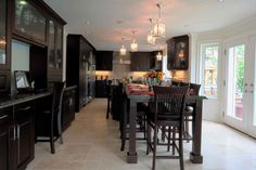 Love this kitchen - dark cabinets with light floors
