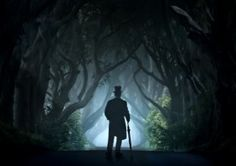 tophat man ireland dark hedges silhouette trees morning alley magic blue dawn umbrella victorian coat branches scenery mood atmopsheric nice pleasant mystery mysterious blaminsky photography