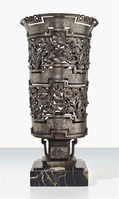 EDGAR BRANDT (1880-1960) A VASE, CIRCA 1927-28 wrought-iron with a marble base 18 ½ in. (47 cm.) high stamped E. BRANDT