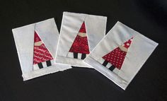 Paper pieced Santas for the Fabric Postcard Swap..  ...soon to be blogged.