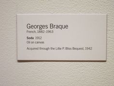 """Classic and straight-forward exhibit label. Easy to read, comfortable to look at, and doesn't distract from artwork. Georges Braque """"Soda"""" 1912"""