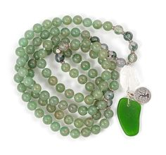 Green Aventurine is thought to be the luckiest of all crystals particularly for manifesting prosperity.  It is supportive of the heart and soothes emotional wounds.  While Moss Agate refreshes the soul and enables you to see beauty in all you behold.  This Mala is finished with a Clear Quartz Guru bead, found hand-drilled green sea glass and a pewter Tree of Life Charm bound with silver wire. Moss Agate, Green Aventurine, Metal Beads, Clear Quartz, Sea Glass, Gemstone Beads, Natural Gemstones, Pewter, Wire