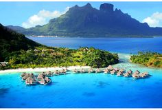 Hilton Nui Resort & Spa in Bora Bora. So beautiful it hurts.    (Even more pictures if you follow the link!)