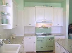 I love this little white and mint green kitchen.  From Oh So Lovely Vintage.