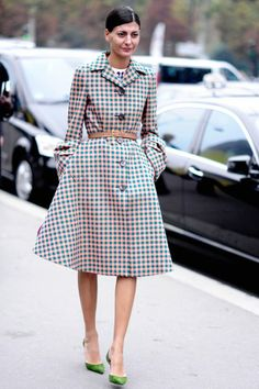 Vogue Best Dressed List 2013  Giovanna Battaglia  The L'Uomo Vogue editor is a street style photographer's dream - always effortlessly chic with plenty of Italian glamour. This ensemble of a Prada belted coat teamed with emerald heels and pulled-back hair - worn during Paris Fashion Week - is the perfect example.