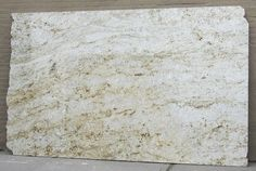 Colonial Gold....Since it's a light colored granite, it's going to be a pretty light/bright kitchen – almost white on white.