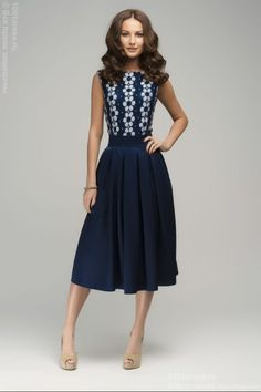 Cute navy colored dress with flowered bodice ~ I like the style of this dress.
