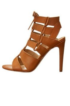 """Dress for success with the Tyler, an elegant stiletto with side zipper closure and lace-up details. 4"""" heel.   Tyler Heels  by Dolce Vita. Shoes - Sandals - Heeled New Jersey"""