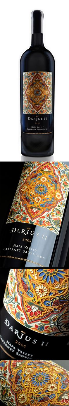 Darioush Darius II Wine Label. Cap og Design PD | wine bottle label  Makes reference to historical Persian Art as recognized in the unity of patterns and bright colours. The overall aesthetic of the bottle is elegant and clean as image and text are centred and the text is structured quite nicely.
