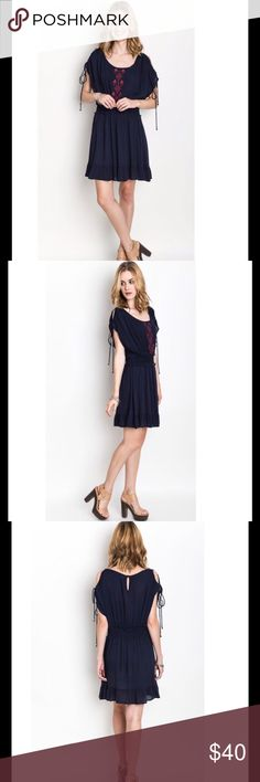 Indigo Shoulder Tie Dress This dress features a flattering scoop neckline, short cold shoulder sleeves with a tie detail, an elastic waistband, and a slight ruffle at the hem.  60% cotton, 40% polyester.  This is a great transition piece from summer to fall. Umgee  Dresses