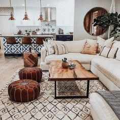 I love to travel, but DAMN it feels good to be home. 💕🏠💕 Built by: cremdevelopment Designed by: lancasterinteriors Custom table by: a_carpenters_son Poufs, Rug & Mirror: luluandgeorgia Tulum Tile: riadtile Custom Puppy Plates: rdkartwork ❤ Boho Living Room, Moroccan Decor Living Room, Moroccan Inspired Bedroom, Tile Living Room, White Couch Living Room, Cozy Living, Small Living, Living Room Mirrors, Living Soaces