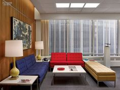 Paneling in the reception area imitates walnut | A tour of Sterling Cooper & Partners Office