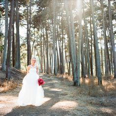 Beautiful bride walking through the woods at The Presdio  Photography by katewebber.com  #brightbridalbouquet