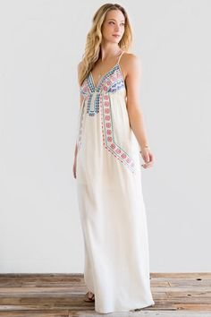 Spring break coming up? Don't for get to pack the Kera Embroidered Maxi Dress! A Beautiful white maxi dress with colorful embroidery. Perfect spring break outfit or honeymoon outfit.