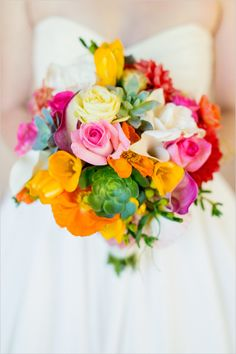 Orange, pink & yellow bridal bouquet by Stems Floral; a classic summer wedding color palette! Bright and cheerful. #summerweddings