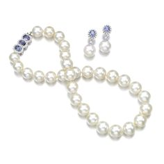Cultured pearl, sapphire and diamond demi-parure Comprising: a necklace designed as a graduated line of cultured pearls measuring from approximately 11.9 to 14.2mm, the clasp set with oval sapphires and brilliant-cut diamonds, length approximately 420mm; and a pair of pendent earrings, post fittings, each with British hallmarks and maker's mark.
