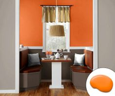 This breakfast nook awakens diners with walls done up in pop of Sherwin-Williams Knockout Orange. | Photo: Courtesy of Sherwin-Williams | thisoldhouse.com