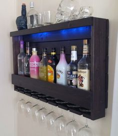 This item is a rustic handcrafted lighted wine rack / liquor cabinet that comes with optional LED lights and features a cleat mounting system with a