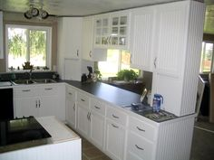 Beadboard kitchen cabinets? The opening is what I want to do into the dining room...  Bet we could do it...