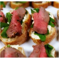 rare roast beef with horseradish creme and rocket on French baguette