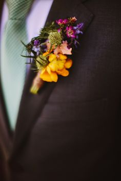 bright spring boutonniere, photo by Pat Furey http://ruffledblog.com/roundhouse-beacon-wedding #grooms