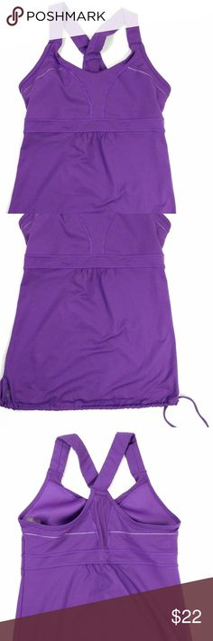 ATHLETA PURPLE TANK TOP SIZE MEDIUM SHELF BRA ATHLETA PURPLE ATHLETIC TOP WITH BUILT-IN SHELF BRA AND A DRAWSTRING WAIST THAT TIES. TOP IS IN GOOD CLEAN CONDITION.  SIZE: MEDIUM  BUST: 16'' ACROSS  LENGTH: 27'' Athleta Tops Tank Tops
