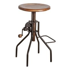 """Offer guests a seat in your home with this with this eye-catching design from C.G. Sparks, bringing a touch of steampunk style to your inspired abode.    Product: Crank stool  Construction Material: Wood and iron  Finish: Old iron lacquer  Features:  Industrial-chic style  Vintage-inspired hand crank bar  Dimension: 27"""" H x 16"""" W x 13"""" D"""