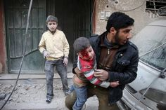 A man carries an injured child in a site damaged from what activists said was shelling by forces loyal to Syria's President Bashar al-Assad in the town of Douma, eastern Ghouta in Damascus, Syria December REUTERS/Bassam Khabieh Syria News, Syrian Children, Crossfire, Photos Of The Week, Vietnam War, Civil Rights, Photojournalism, People Around The World, Beautiful Children
