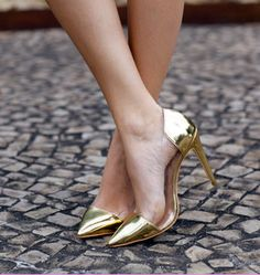 Luiza Barcelos gold heels