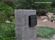 Even the mailbox is cool, done up in board-formed concrete. (The rill in the courtyard is constructed of board-formed concrete too. Mailbox Stand, Mailbox Post, Mailbox Ideas, Board Formed Concrete, Poured Concrete, Mailbox Landscaping, Modern Landscaping, Landscaping Ideas, Brick Mailbox