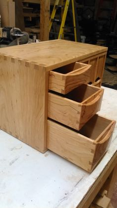 These small cabinets are for dispensing individually wrapped tea bags. The tea bags are loaded in the back and the tea bag is pulled out the front crescent shaped hole. The top cabinet is made with. Tea Storage, Small Cabinet, Outdoor Furniture, Outdoor Decor, Cabinets, Woodworking, Home Decor, Armoires, Decoration Home