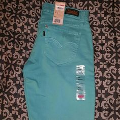 Colored LEVI'S 524 SKINNY JEANS Brand new with tags, never worn Levi's jeans! ♥524 style teal colored jeans ♥Style says skinny, fits more like a straight leg ♥Size 7 M (Juniors) ♥Fashionable tears at the knees Levi's Jeans Skinny
