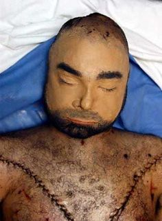 Uday Hussein with reconstructed face in Air Force morgue - The Weird Picture Archive