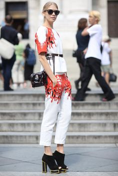This Is It — A Look Back at the Year's Best Street Style : Bold print acts like a frame on this white top and trouser set — the whole look also gets a lift via platform open-toe booties.