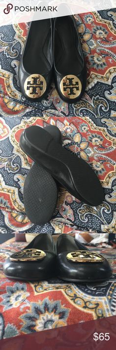 Black and gold Rivas Good condition! Some scuffs from normal wear but they look great! I wear a 7.5 and these fit me. Will polish before sending! Tory Burch Shoes Flats & Loafers