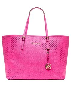 This perforated #pink MICHAEL by Michael Kors #handbag is perfect for travel
