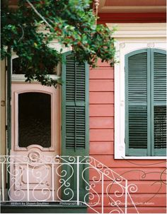 another pink door; what can I say, I love the look! I also love the closed arched shutters!