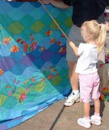 "Carnival Booth Ideas ~ Fishing Booth: Children choose a fishing pole and swing the ""hook"" over the screen.  Volunteers hidden behind the screen clip on a prize and then give the line a few tugs.  Children ""reel in"" their prize by pulling their line back over the screen.  Helpful Hint: Make sure their poles and lines are not too long - they only need to be 2 - 3 feet in length.  Practice with a few children of different ages to see what works best."