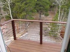 Wire & Wood, these are the railings I want for our deck-keeps the view more open.